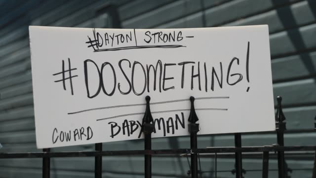 """dayton, ohio, usa: a sign reads, """"#dosomething,"""" at the site of sunday morning's mass shooting that left 9 dead, and 27 wounded, wednesday, august 7,... - dayton ohio stock videos & royalty-free footage"""