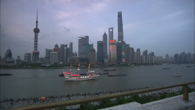 day-to-night sequence of huangpu river, shanghai - global communications stock videos & royalty-free footage