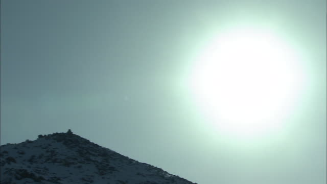 dazzling sun_sunshine_daisetsuzan volcanic group in winter, hokkaid_ - daisetsuzan volcanic group stock videos and b-roll footage