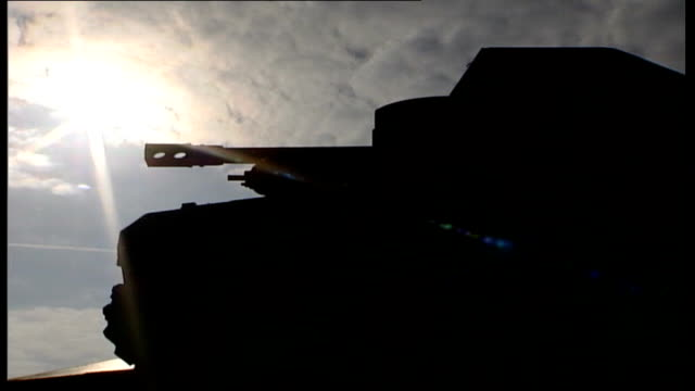 stockvideo's en b-roll-footage met 60th anniversary memorial reunion itn france normandy ext la ms tank silhouetted against sun as v/o poem 'we will remember them' recited cms dday... - literatuur
