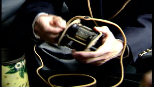 60th anniversary memorial reunion; itn france: normandy: int cms andre heintz putting on headphones cms heintz handling crystal radio set andre... - anniversary stock videos & royalty-free footage