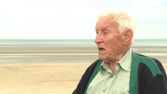 british and german veterans harry read and paul golz meet france normandy paul golz on beach with reporter various of people on beach overlaid***... - other stock videos and b-roll footage