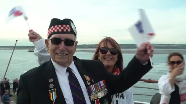 Flotilla carrying veterans to repeat fateful journey made by troops during the war ENGLAND Portsmouth EXT **Band playing SOT** Veterans and people...