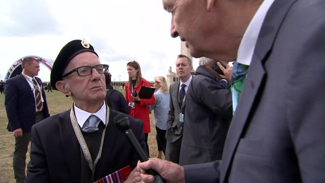memories of veterans england hampshire portsmouth ext corporal jim healy interview sot flight lieutenant douglas smith setup shots with reporter /... - jon snow journalist stock-videos und b-roll-filmmaterial