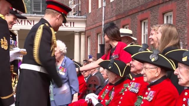 prince harry visiting chelsea pensioners england london chelsea ext prince harry duke of sussex talking to seated chelsea pensioners / harry stood on... - other stock videos and b-roll footage