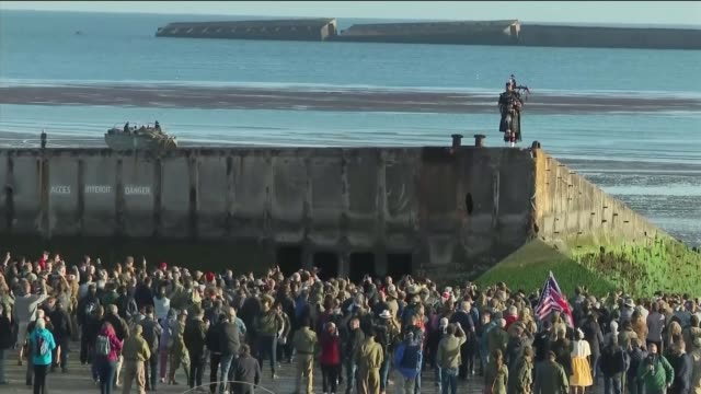 vídeos de stock, filmes e b-roll de veterans and world leaders attend services in normandy france normandy arromanches ext / dawn wide shot sun rising over english channel wwii concrete... - arromanches