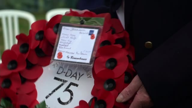 veterans and world leaders attend services in normandy france normandy bayeux bayeux war cemetery various of veterans along in wheelchairs and crowd... - wreath stock videos & royalty-free footage