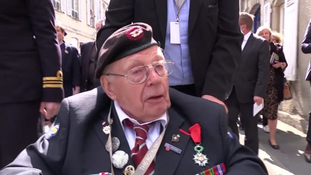 veterans and world leaders attend services in normandy france normandy bayeux ext various of veterans along in wheelchairs and crowd applauding alan... - spire stock videos & royalty-free footage