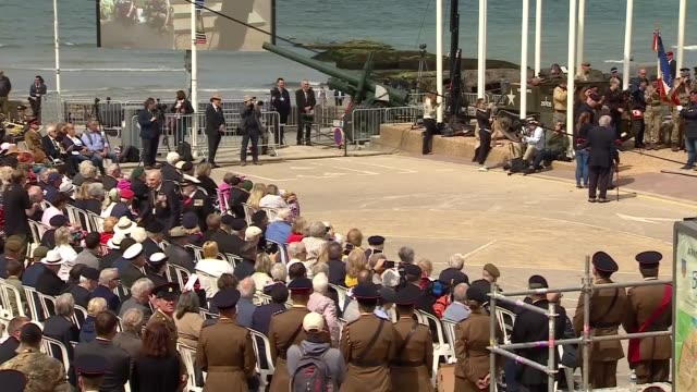 Veterans attend service in Arromanches FRANCE Normandy ArromancheslesBains Place du Six Juin 1944 EXT **Music heard SOT** Various shots of people...