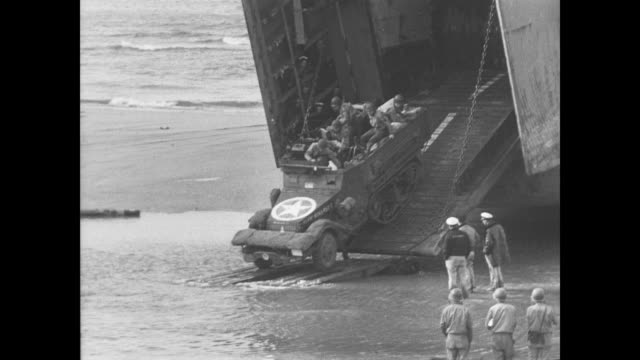 day - allied soldiers move inland from normandy beaches as lsts unload cargo - 1944 bildbanksvideor och videomaterial från bakom kulisserna