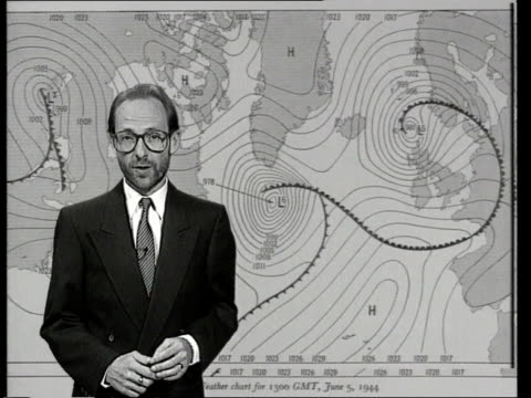 dday celebrations weather int/ england london cms alex hill in front of old fashioned weather map giving forecast as it might have been in 1944 sot... - hampshire england stock videos and b-roll footage