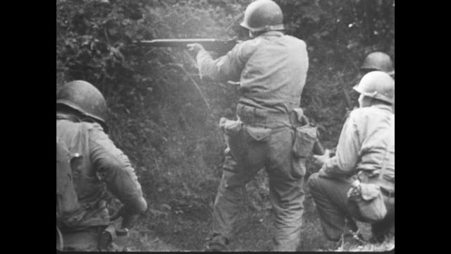 day fighting moves inland into normandy as medics tend to wounded allied soldiers - normandie stock-videos und b-roll-filmmaterial