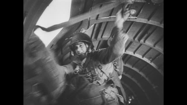 day invasion begins as paratroopers drop into normandy - fallschirmjäger stock-videos und b-roll-filmmaterial