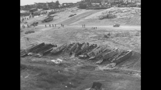 day - normandy beaches are secured into allied hands - 1944 bildbanksvideor och videomaterial från bakom kulisserna