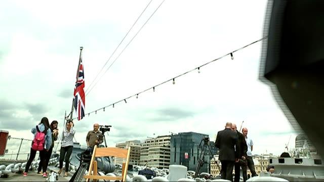 day veterans attend hms belfast ceremony england london hms belfast ted cordery interview sot various shots bill matthews sat on deck of ship in... - アロマンシェス点の映像素材/bロール