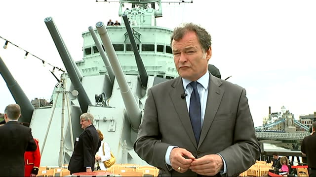 day veterans attend hms belfast ceremony england london reporter to camera john seares showing reporter guns which he operated on board hms belfast... - アロマンシェス点の映像素材/bロール