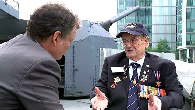 veteran interviews and cameron cutaways john seares interview sot talks of taking part in the dday landings and manning the ship's 4 inch guns - アロマンシェス点の映像素材/bロール
