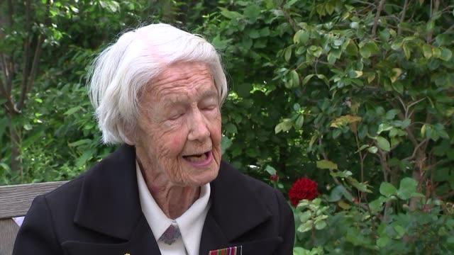 day veterans awarded the legion d'honneur marsie taylor interview england london french ambassador's residance ext marsie taylor interview sot on... - アロマンシェス点の映像素材/bロール