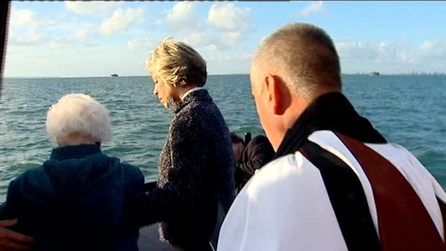 dday victims honoured in special memorial service at sea at sea the solent ext margaret emmett onto deck of boat for service to honour her fiance and... - landing craft stock videos & royalty-free footage