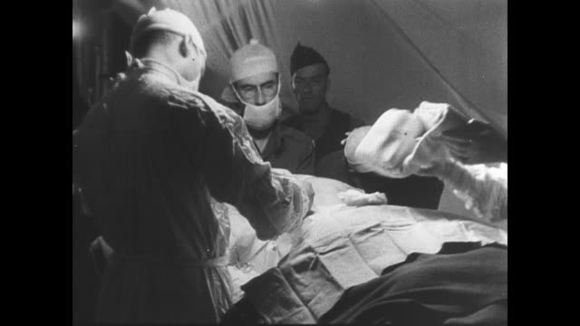 vidéos et rushes de day wounded allied soldiers needing urgent specialized surgery are brought to field hospital in normandy - masque de protection