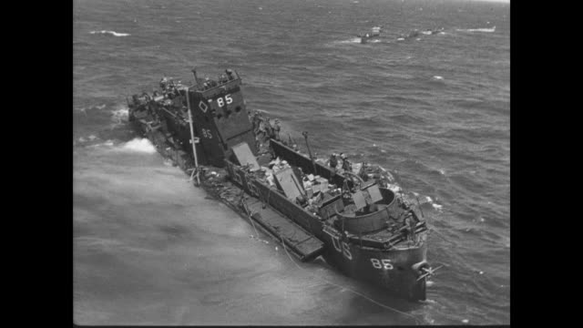 day - wounded soldiers are transported off of damaged coast guard landing craft infantry boat - 1944 bildbanksvideor och videomaterial från bakom kulisserna