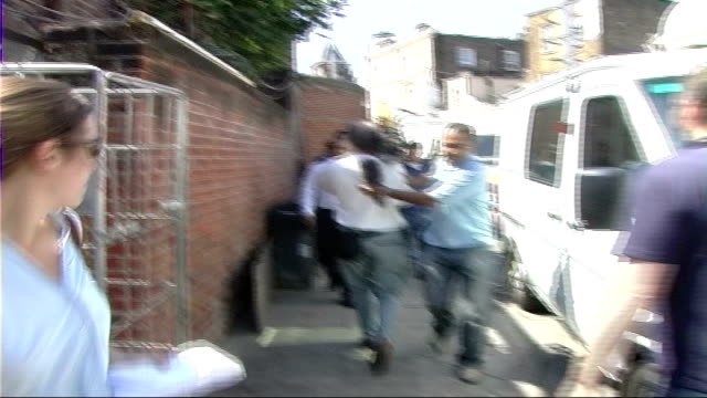 family press conference; england: london ext de menezes family members walking along towards press conference venue / media following / family,... - spokesman stock videos & royalty-free footage