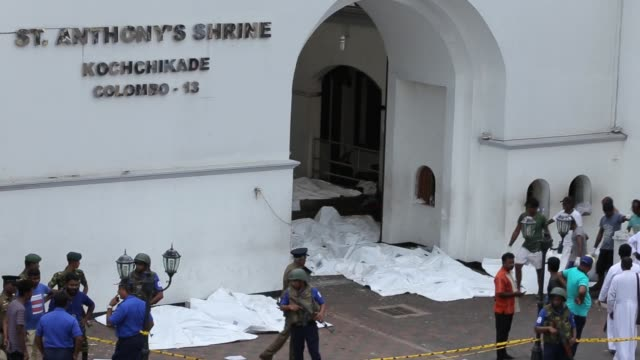 dead bodies are carried away front of the st anthony's church where an explosion took place in kochchikade colombo sri lanka on april 21 2019 at... - sri lanka stock videos and b-roll footage