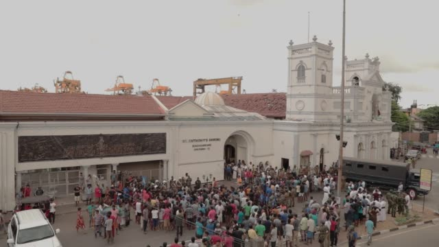 dead bodies are carried away front of the st anthony's church where an explosion took place in kochchikade, colombo, sri lanka, on april 21, 2019.-... - sri lanka stock videos & royalty-free footage