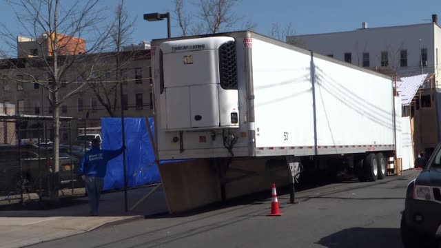 dead bodies of coronavirus victims have been carried into a refrigerated truck outside a hospital morgue in new york city recent footage shows... - new york stato video stock e b–roll