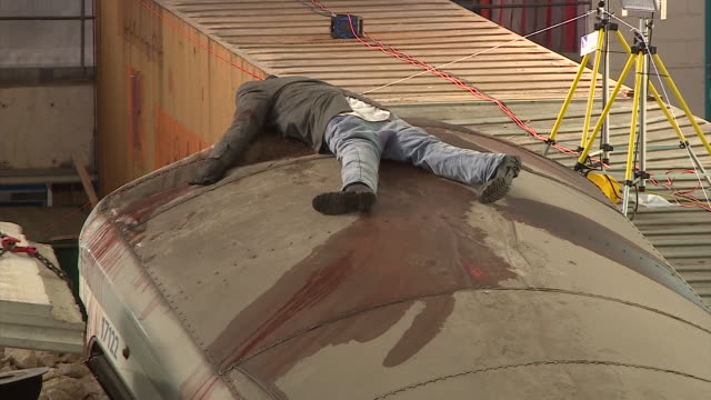 dead body' dummy lying on top of a tube carriage during an emergency response team training exercise which features a mock 'waterloo underground... - dirty stock videos & royalty-free footage