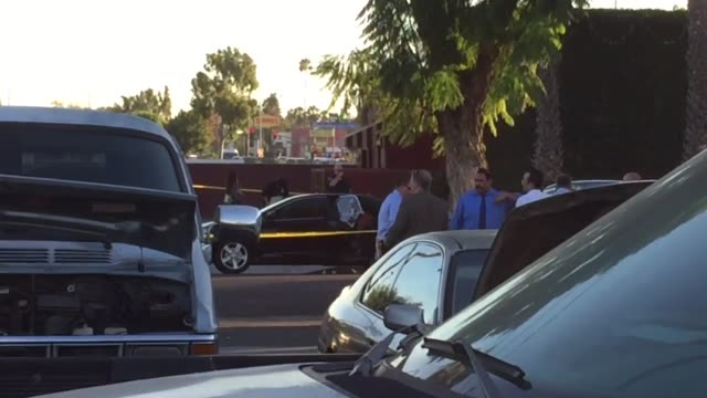 A dead body was found shot in back of a Toyota Camry in Fullerton CA reportedly the deadly result of a love triangle Footage includes various shots...