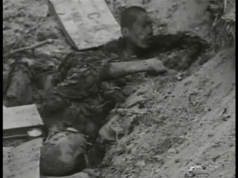 dead north korean soldiers. pows walking out of bunker w/ arms raised. one wounded teenage soldier w/ bandage on eye being frisked. the cold war,... - cold war stock videos & royalty-free footage