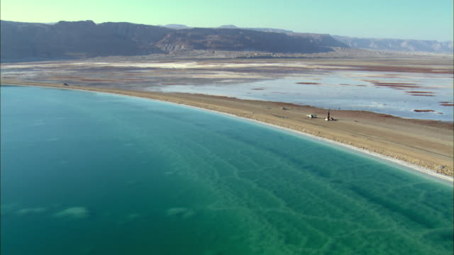 ws aerial zi dead sea along with mount sodom / sourn judea desert, israel    - dead sea stock videos and b-roll footage