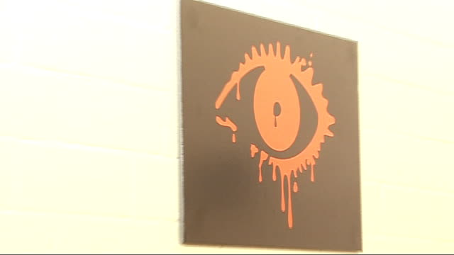 'dead set' zombie series: interviews; e4 logo with blood spatter / poster of big brother eye logo dripping blood charlie brooker interview sot - the... - ポピュリズム点の映像素材/bロール
