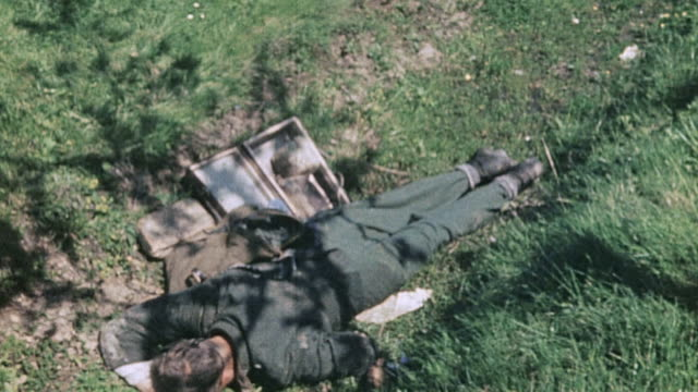 dead waffen ss soldiers lying in field where they were killed / czech republic - wehrmacht stock-videos und b-roll-filmmaterial
