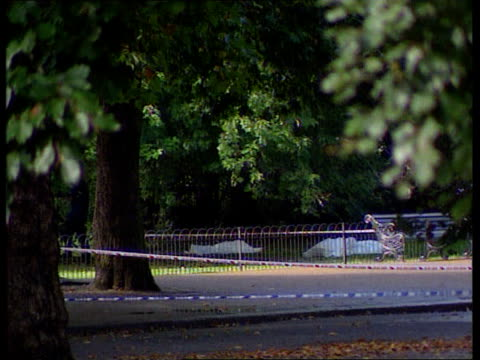 TERRY ENGLAND London Hyde Park EXT Army officers on horse back slowly along in distance as cars to fro in f/g Cordonned off area of park with two...