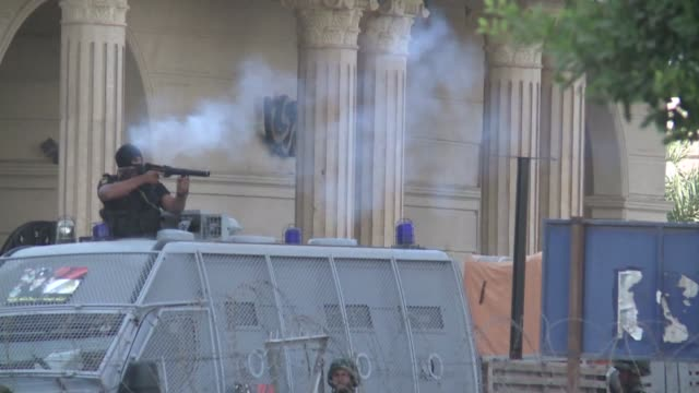 deadly gunfight erupted in cairo on friday as thousands of supporters of deposed egyptian president mohamed morsi marched on the republican guard... - coup d'état stock videos & royalty-free footage