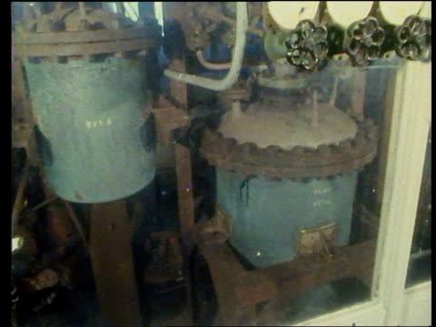 deadly nerve gas in subway terrorist attack; itn lib england: cornwall: nancekuke factory seq exterior; interior plant; dial; valves; - terrorism stock videos & royalty-free footage