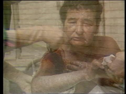 deadly nerve gas in subway terrorist attack; itn lib iraq: kurdistan: halabja gv village street l-r as corpses lie on ground l-r seq victims being... - terrorism stock videos & royalty-free footage