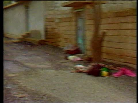 deadly nerve gas in subway terrorist attack; itn lib iraq: kurdistan: halabia gv village street l-r as corpses lie on ground l-r int seq victims... - terrorism stock videos & royalty-free footage