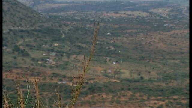 Deadly new strain of tuberculosis spreading SOUTH AFRICA Kwa Zulu Natal EXT General views of rolling hills People away along rural road with hills in...