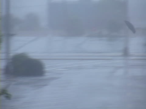 deadly pieces of debris fly through the air as hurricane force winds batter gulfport ms during hurricane katrina in august 2005 - 2005 stock videos and b-roll footage