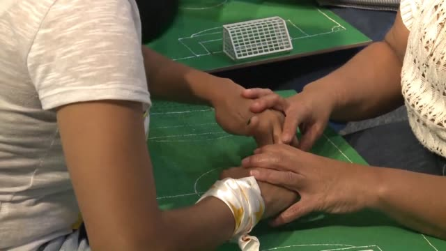 deaf and visually impaired brazilian football supporters experience the world cup thanks to specialists who comment on the game by guiding their... - hearing impairment stock videos & royalty-free footage