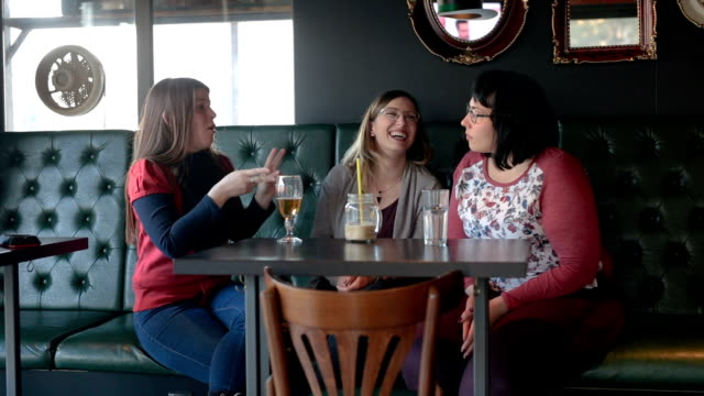 deaf friends enjoying drinks at the cafe - sign language stock videos & royalty-free footage