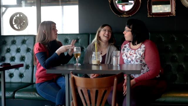 Deaf friends enjoying drinks at the cafe