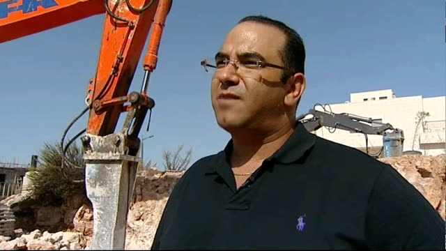 deal could halt west bank settlement building; israel: west bank: ext machine drilling ground construction worker drilling sequence ronen mizrachi... - man and machine stock videos & royalty-free footage