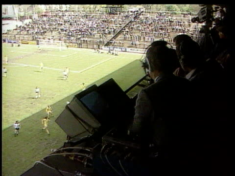 bskyb deal london fulham craven cottage bv brian moore watching match bv cameraman watching match ms monitors in ob truck brian moore watching match - sports commentator stock videos & royalty-free footage