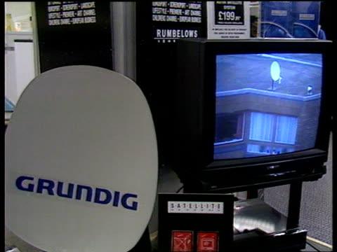 "deal; tv sets and satellite dishes (bearing ""grundig"" name on sale in shop tv set in shop showin ""sky tv"" logo - bericht film und fernsehen stock-videos und b-roll-filmmaterial"