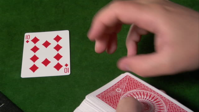 dealer's point of view laying down the flop in game of texas hold'em - gambling chip stock videos and b-roll footage