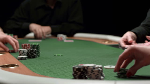 hd dolly: dealing cards for texas hold 'em poker game - gambling chip stock videos & royalty-free footage